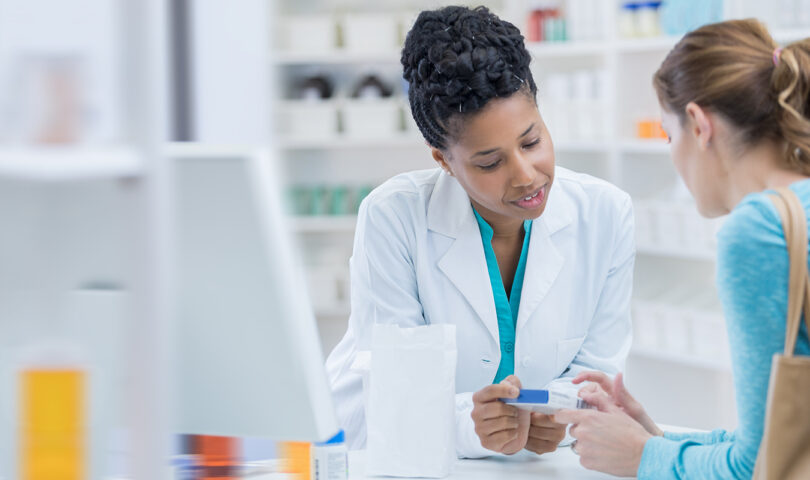 Pharmacist and patient discussion