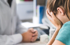 Pharmacist consulting distraught patient