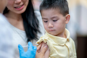 Banner Fall 2020 Expanded Scope - child getting flu shot