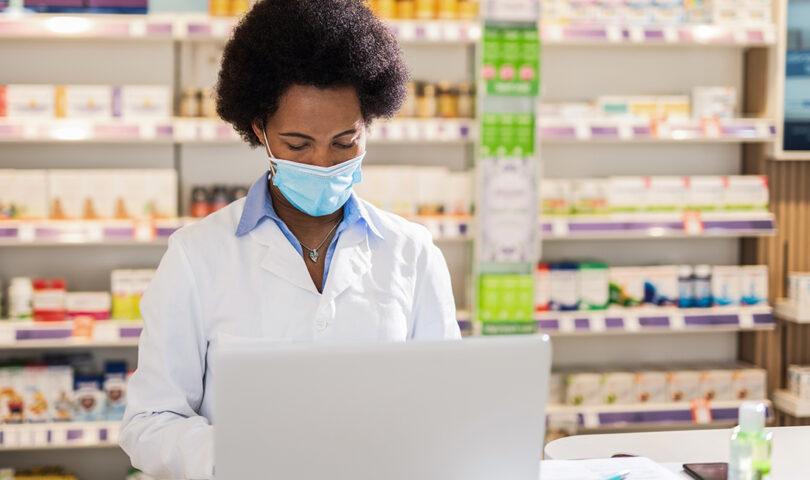 Pharmacist using computer