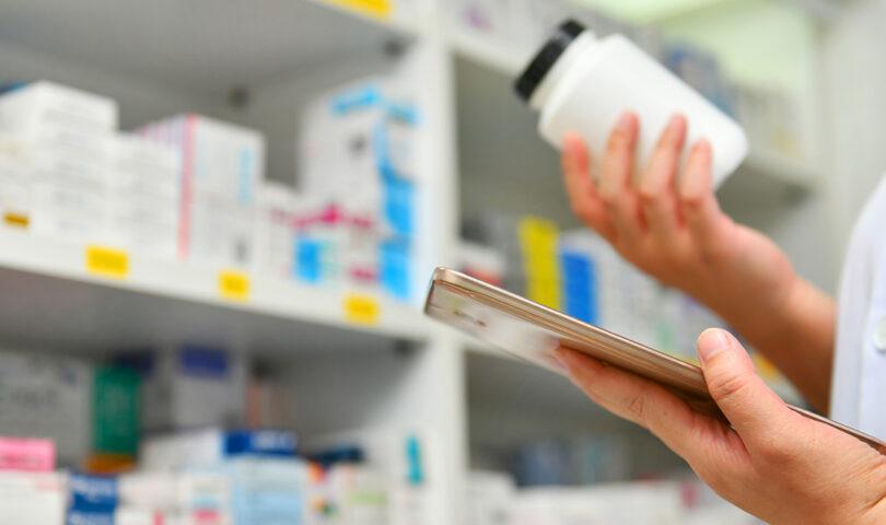Pharmacist looking at generic bottle