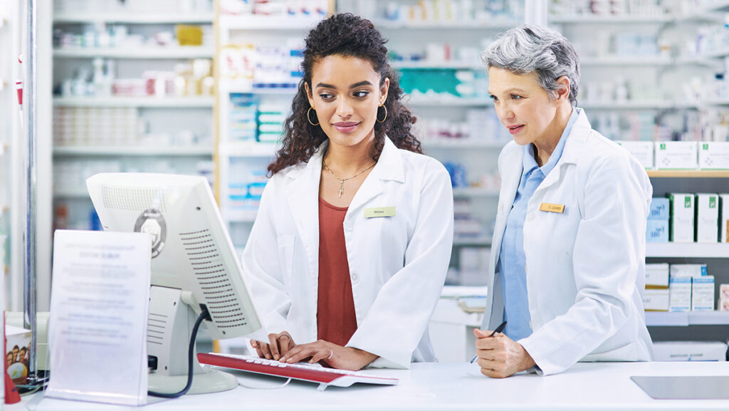 Pharmacist and manager at a computer