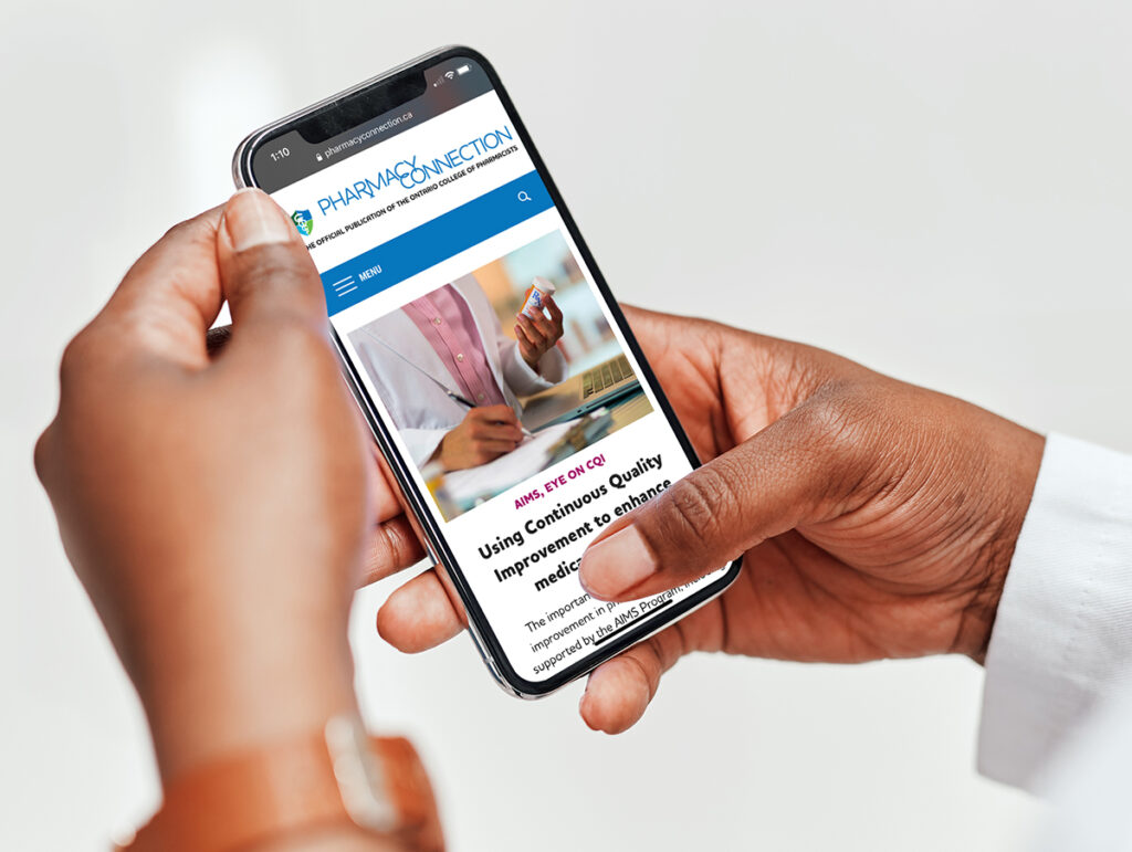 Pharmacist viewing pharmacyconnection.ca on a phone
