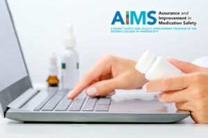 Pharmacist checking medication at their laptop